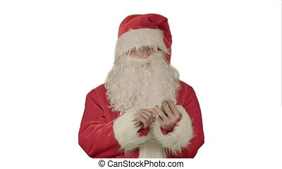 Santa claus reads and sends text messages from his cell phone  on white background