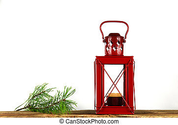 Santa Claus red Christmas lantern and a pine tree twig at...
