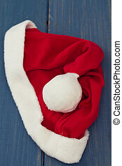 Santa Claus red hat on blue wooden background