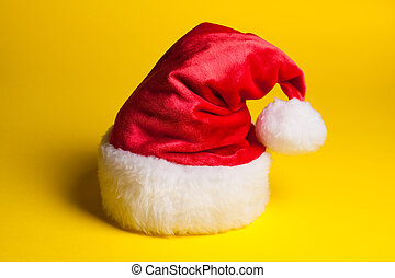 Santa Claus red hat on yellow background