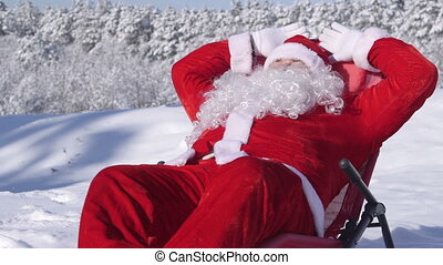 Santa Claus relaxing in a snow