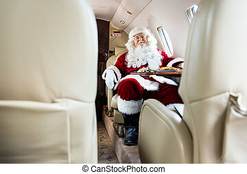Santa Claus Relaxing In Private Jet