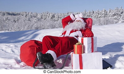 Santa Claus relaxing in snow covered winter forest