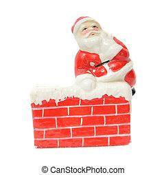 Santa Claus resting on a chimney