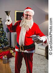 Santa claus ringing a bell at home