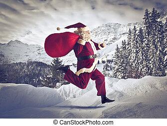 santa claus running - santa claus runs with his big sack in...