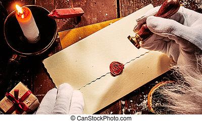 Santa Claus sealing a vintage envelope