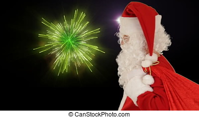 Santa Claus sends a kis and wave, against holiday fireworks