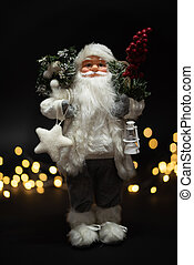 Santa Claus shot against dark background with magical golden bokeh