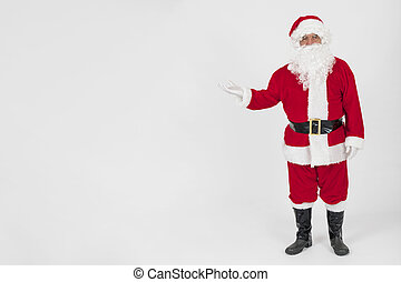 santa claus showing empty hand . High quality and resolution beautiful photo concept