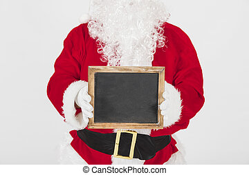 santa claus showing empty wooden frame. High quality and resolution beautiful photo concept