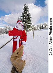 Santa Claus, Father Christmas holds present