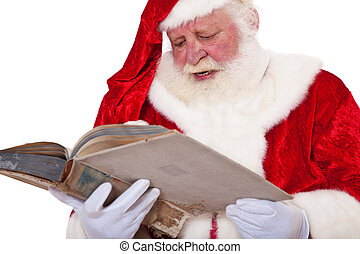 Santa Claus in authentic look reading in old book. All on...