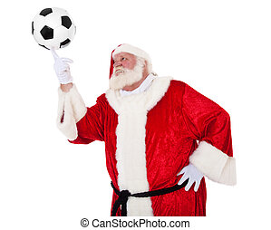 Santa Claus in authentic look playing with soccer ball. All...