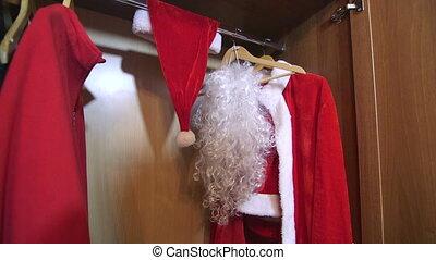 Santa Claus suit costume hanging in the wardrobe