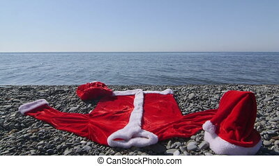 Santa Claus suit costume on the beach