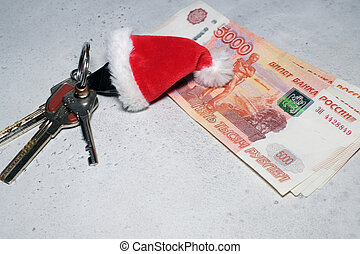 Santa Claus theme: Santa's hand holding the keys to a new appartament