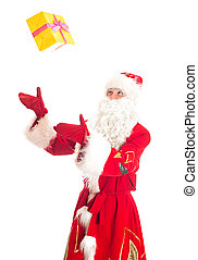 Santa Claus throws gift. Isolated on white.