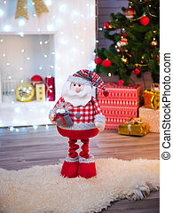 Santa Claus toy on Christmas decorations.