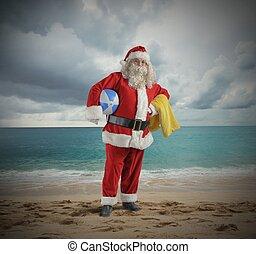 Santa claus vacation - Santa Claus play in a tropical beach