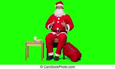Santa Claus waiting  against a green screen