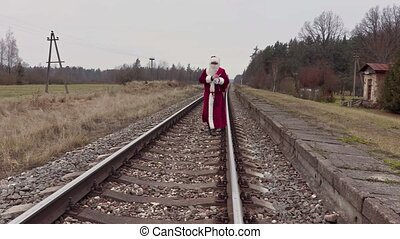 Santa Claus walking on railway