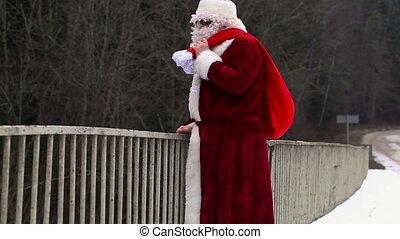 Santa Claus waving hand on the brid