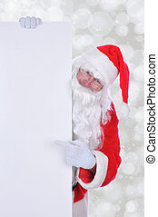 Santa Claus with a Blank Sign with copy space