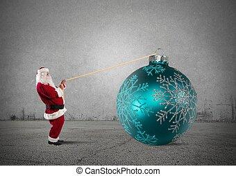 Santa Claus with big Christmas ball