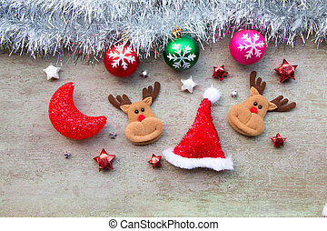 Santa claus with Christmas decoration on wood background.