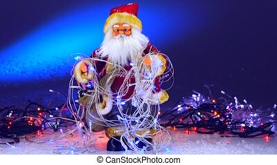 Santa Claus with Christmas garlands