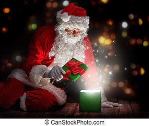 Santa Claus with christmas gifts - Santa Claus opening a...