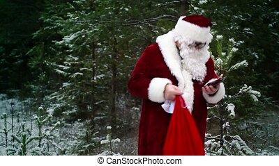 Santa Claus with gift bag talking