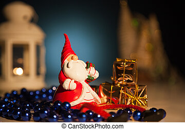 Santa Claus with gifts lights background