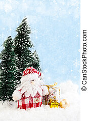 Santa Claus with gifts on snowy background