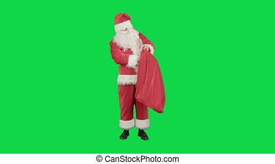 Santa Claus with his sack of lots of presents on a Green Screen Chrome Key
