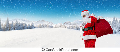 Santa Claus with panoramic alpine winter landscape