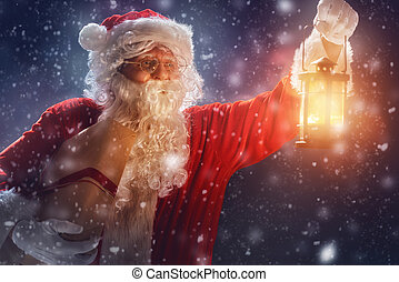Santa Claus with present. - Merry Christmas and happy...