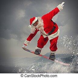 Santa Claus with snowboard