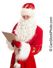 Santa Claus with tablet pc. Isolated on white.