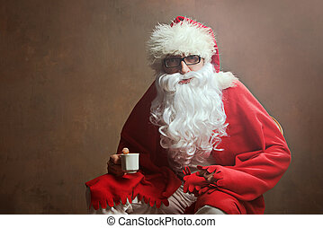 Santa Claus with the cup of coffee