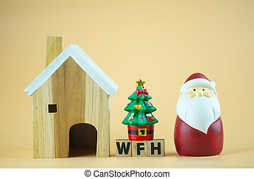 Santa claus working at home. Christmas tree on wood block of WFH