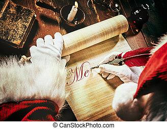 Santa Claus writing an Xmas greeting on a scroll