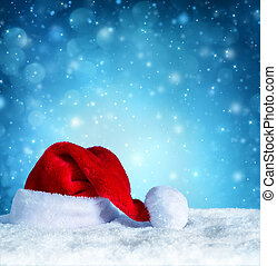 santa clause hat with snow and blue snowfall background