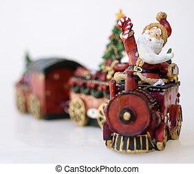 Santa Clause ornament, on train bringing gifts.