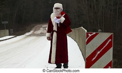 Santa Clause try to stop car on the bridge