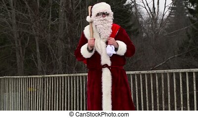 Santa Clause with  baseball bat on the bridge