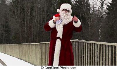 Santa Clause with gift bag and  baseball bat on the bridge