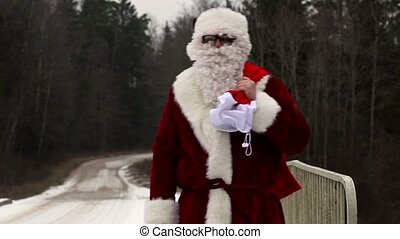 Santa Clause with  gift bag on the bridge