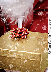 Santa clause with yellow present box in his hands.